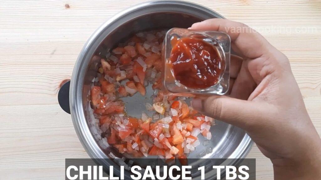 Paneer tikka pizza tomato sauce chili sauce