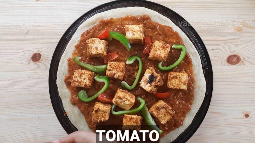 Paneer tikka pizza base apply tomato
