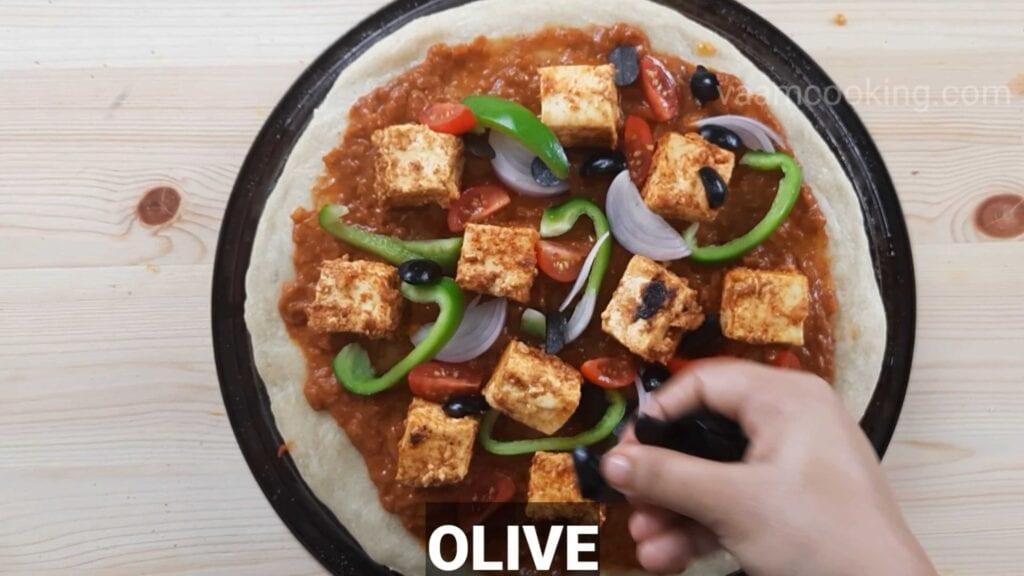 Paneer tikka pizza base apply Olive