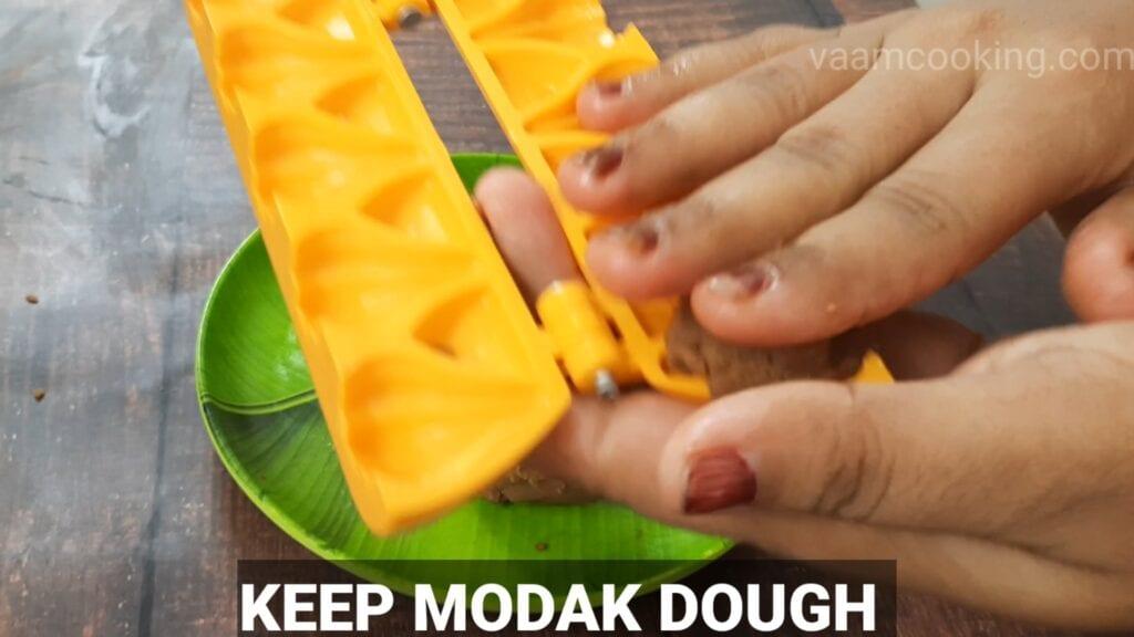 chocolate-modak-recipe feel mold with modak dough