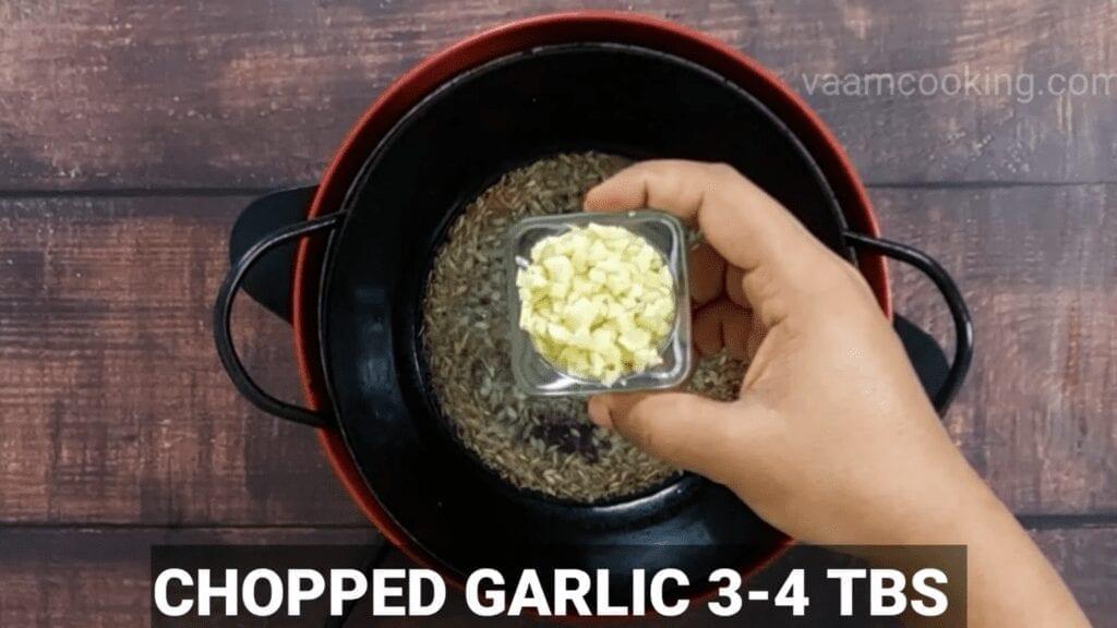Mudda-bhaji-recipe-tadka-copped-garlic